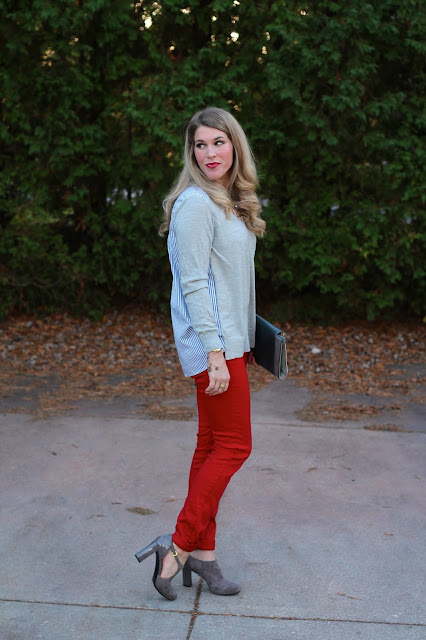 Striped back sweater, red jeans, taupe booties, grey clutch