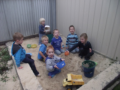 children learning sand