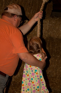 Grandpa helps Sierra with the rope swing at Purina Farms