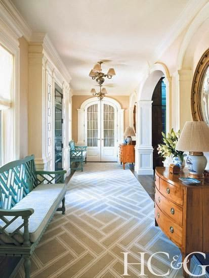traditional beige hallway foyer with pops of turquoise