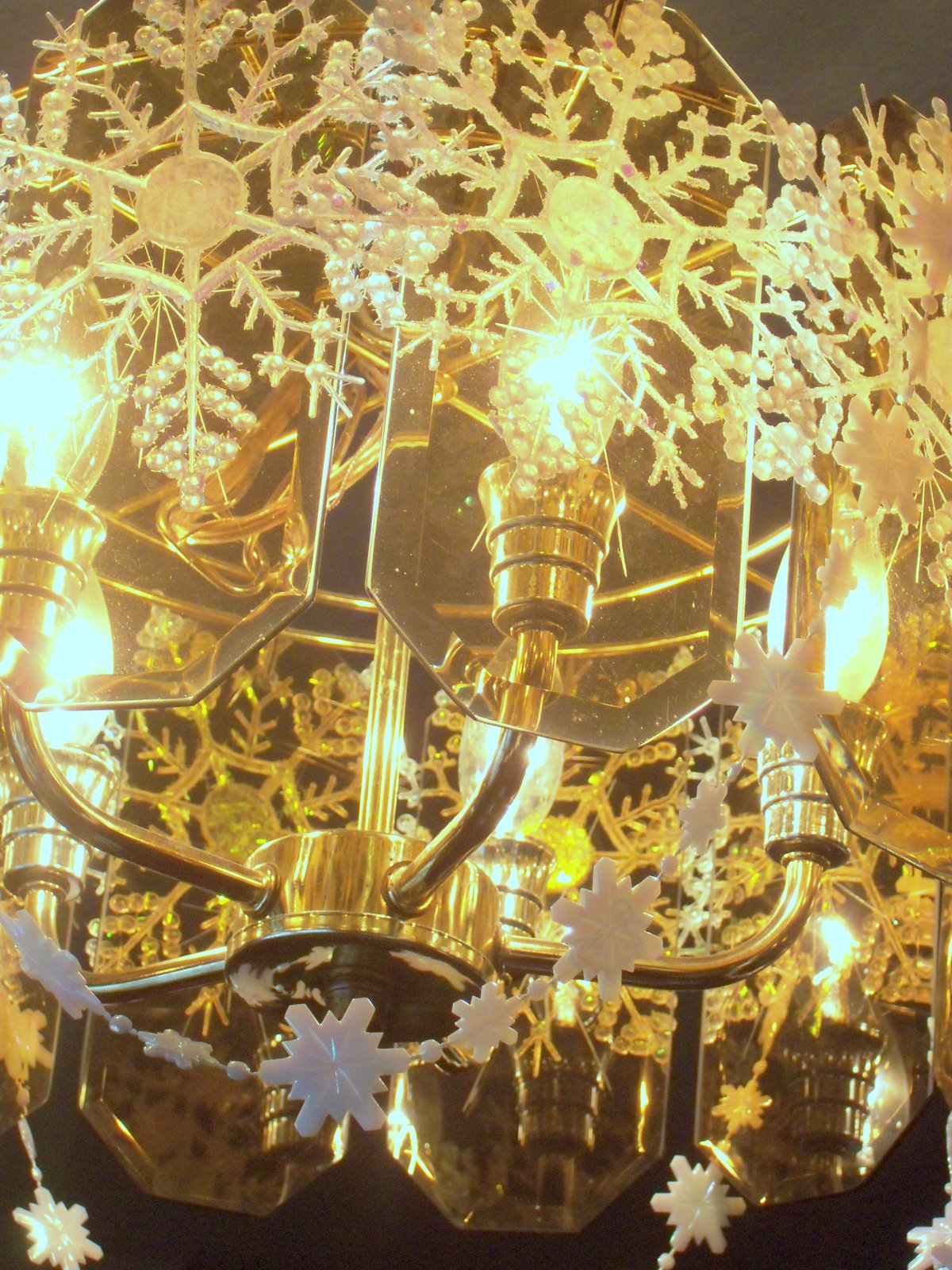 Make the best of things snowflake chandelier first version and i still have snowflakes left ill try hanging more around the bottomor leave it like this i can hardly wait to see it after dark mozeypictures Choice Image