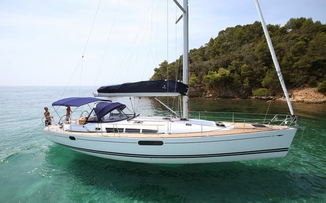 Jeanneau Sun Odyssey sailboat in a bay - boatforrent.com