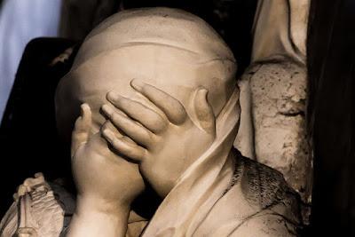 woman moarning tomb
