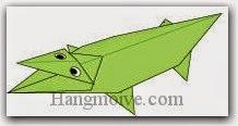Bước 31: Vẽ mắt để hoàn thành cách xếp con cá sấu bằng giấy theo phong cách origami.