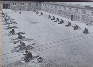 nelson mandela's prison yard on robben island with political prisoners breaking rocks