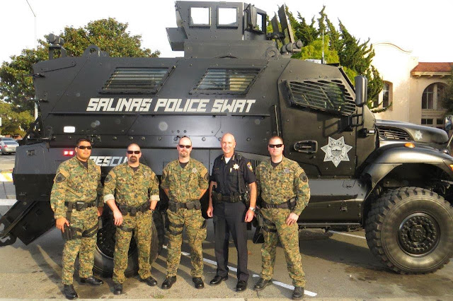 Salinas Police SWAT Officers Posing In Front Of MRAP