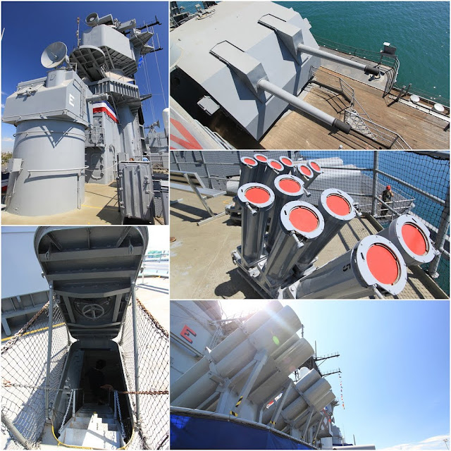 From top to bottom on the right, 16 inch Gun Armored Turrets weight 2000 tons each with ammunition and 6 missile at Battleship USS IOWA BB61 in Los Angeles, California, USA