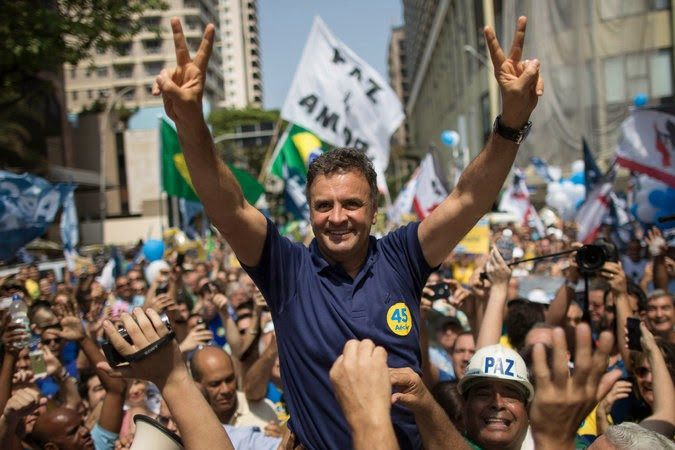 "The New York Times wanted you to know that Aecio Neves was Brazil's  ""pro-growth"" candidate. (photo: Felipe Dana/AP)"