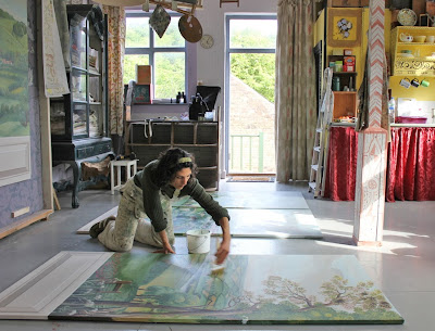 Melissa matte varnishing the canvases