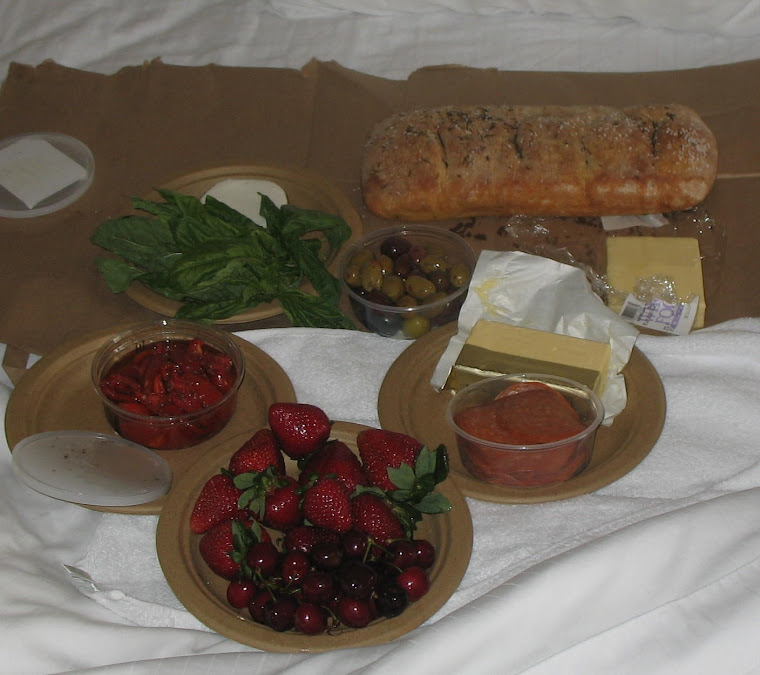 First CA Dinner: Roasted Tomatoes, Basil, Olives, Rosemary Ciabatta, Cheese, Fresh Fruit- YUM!