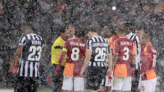 Galatasaray and Juventus players stand on the pitch as their Champions