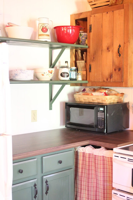 Cabin Kitchen makeover with bead board, open shelving and a removable countertop vis www.goldenboysandme.com