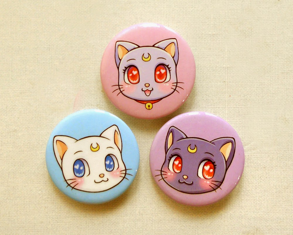 http://beaglecakes.storenvy.com/collections/582607-pins-keychains-magnets/products/12344487-sailor-moon-cats-1-75-pinback-button-set-of-3-sailor-moon-anime-luna-arte