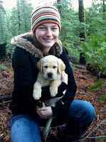 Carrie Faber holds a young guide dog puppy