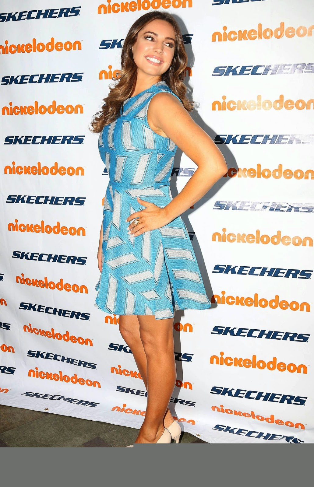 Kelly Brook flaunts legs in a flirty blue dress at charity event in California