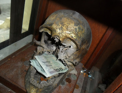 broken-skull-money-corrections-museum-bangkok-thailand.JPG