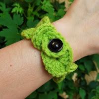 http://www.etsy.com/listing/162354755/crochet-wave-bracelet-made-of-green-wool?ref=shop_home_active