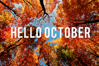 Hello October with fall leaves in the background