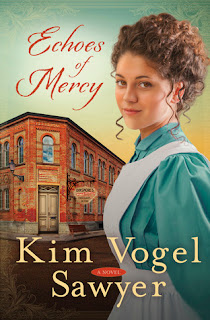 cover of Echoes of Mercy by Kim Vogel Sawyer shows a brunette wearing an aqua dress covered by a white apron in front of a corner store