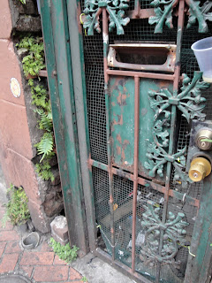 Real leaves in the cracks and the wrought iron leaves on the gate make it leafy.