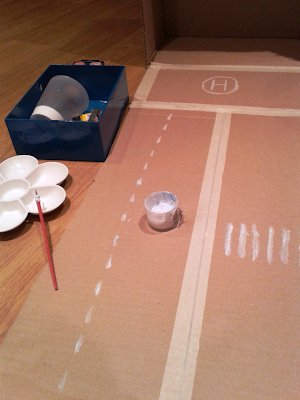 como hacer juguete con caja de carton