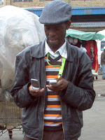 Matlabe juggling 2 cell phones in Maseru