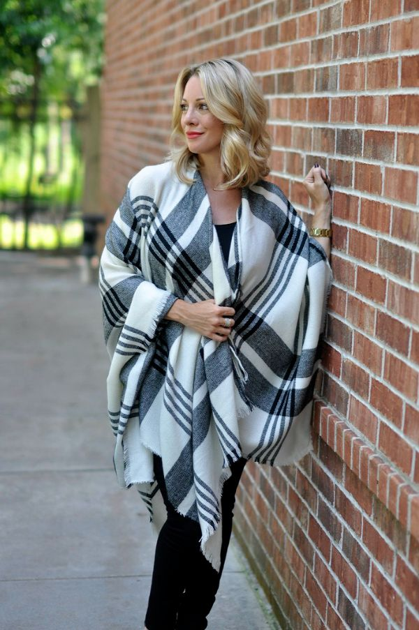 Fall Fashion - black and white plaid poncho with black skinny jeans and heels