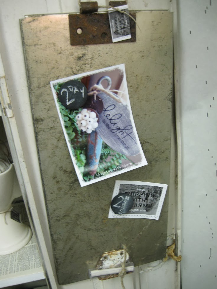 Chipping with Charm: metal shelf turned memo board...http://www.chippingwithcharm.blogspot.com/