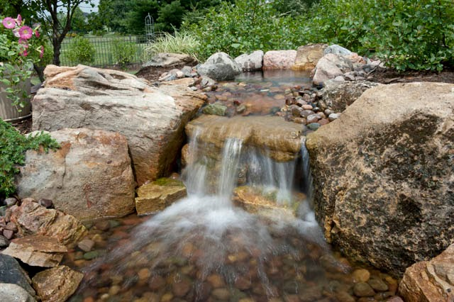 Cool small back yard water falls home staging for Yard waterfalls