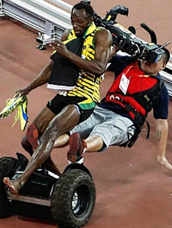 Segway, Usain Bolt, Segway PT, Usain, Bolt, 100 meter, Record, Fastest man, Collision, Collides, Video, Cameraman, 200 meter, 200m, Celebrations, Beijing , China, Beijing, Sprint, Olympic, Jamaican, Jamica, 2015, August