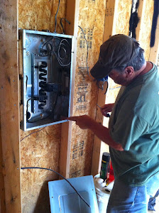 Tim working on the electrical box