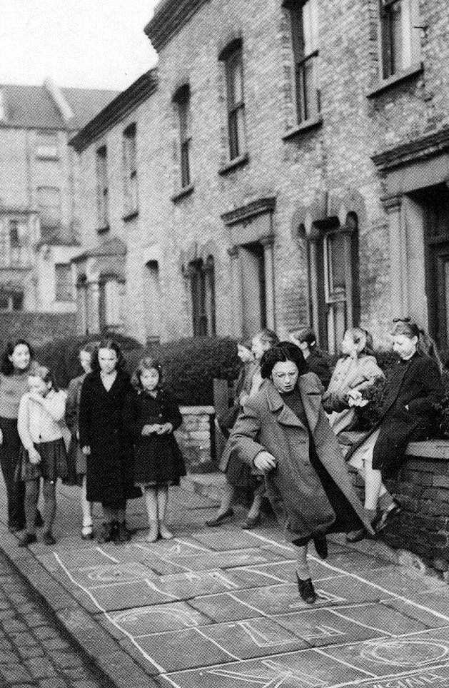 Old photograph of children playing in the street in glasgow scotland