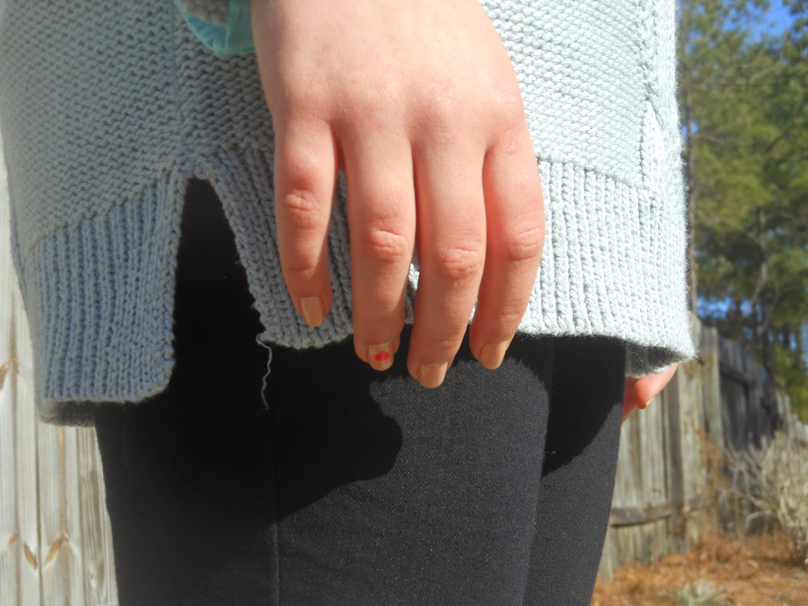 Pops of Blue. Grey oversized sweater, polka dot button down, black jeans, black ankle boots, feminine jewelry