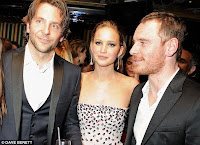 Fassbender meets up with Bradley Cooper and Jennifer Lawrence at a BAFTA after-party in London on Sunday.