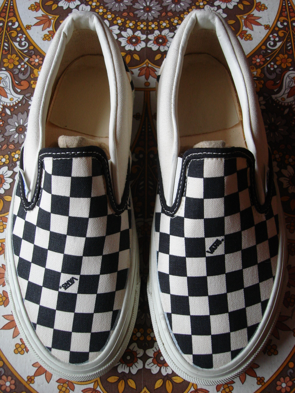 vans checkerboard slip on history