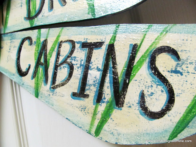 hand painted words and lettering on table leg dragonfly wings