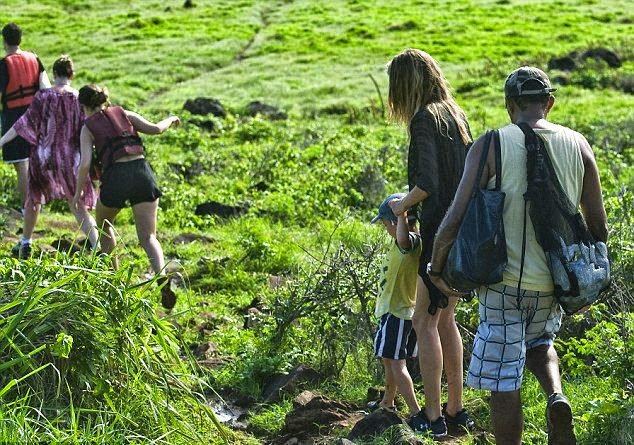 Gisele Bundchen walking for a rocky hike through the grassy terrain of the Brazilian island on Friday,‭ ‬April‭ ‬4,‭ ‬2014