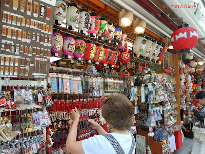 Wall Hangings and other good luck charms on display in Nakamise Shopping arcade, Sensoji temple, Japan