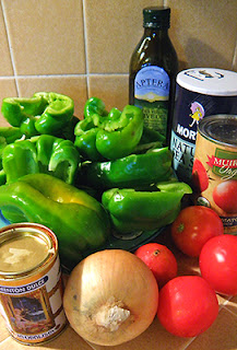 Halved bell peppers, onion, tomatoes, spices, oil, and tomato sauce