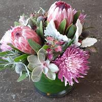 http://atlantaflowerbar.bloomnation.com/atlanta-flower-bar/protea-and-succulent-surrender.html