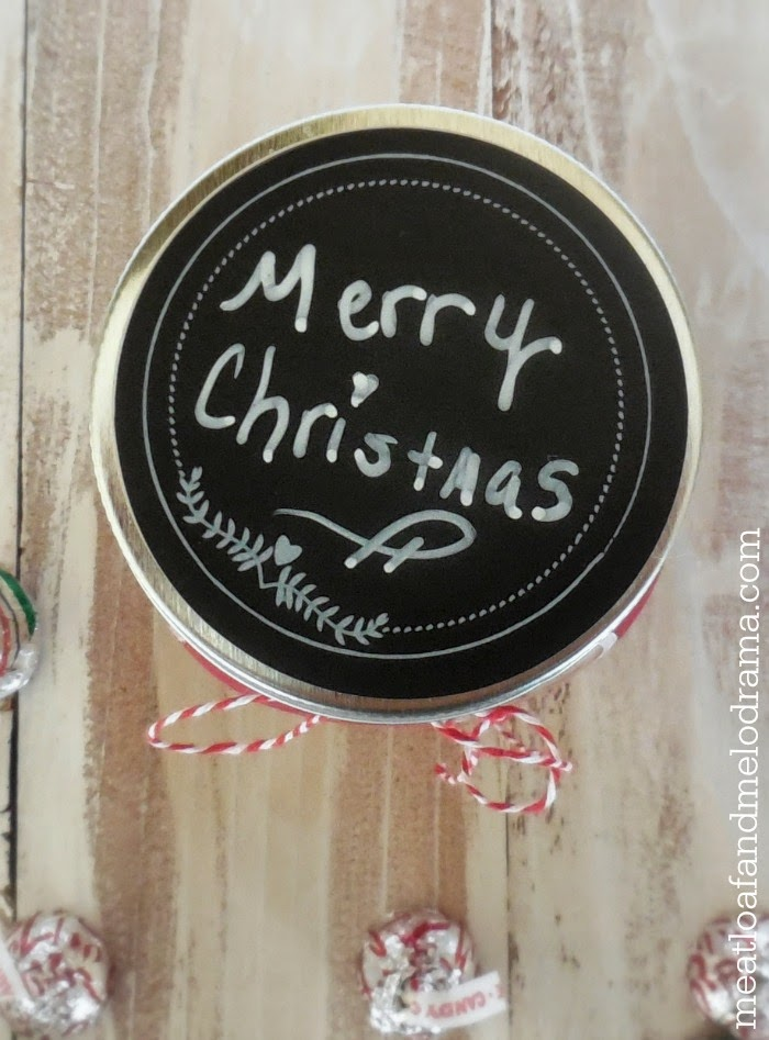 add chalkboard label and write merry christmas on top of lid of mason jar