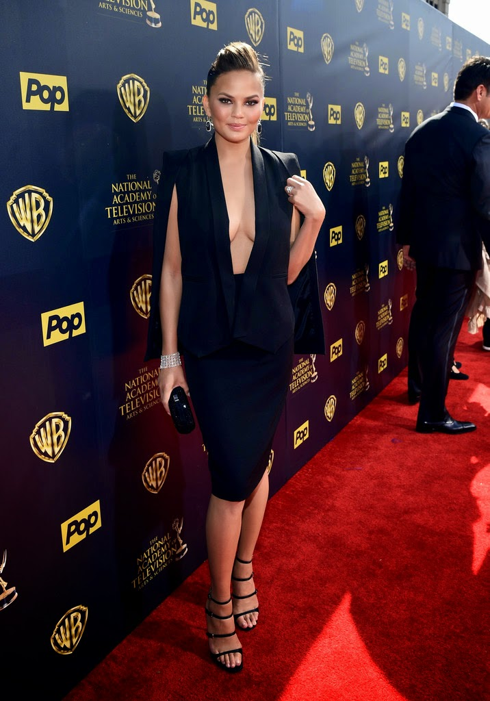 Chrissy Teigen shows off ample cleavage at the 2015 Day Time Emmy Awards in Burbank