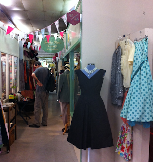 Vintage dresses in the corridor of Wood Street Market