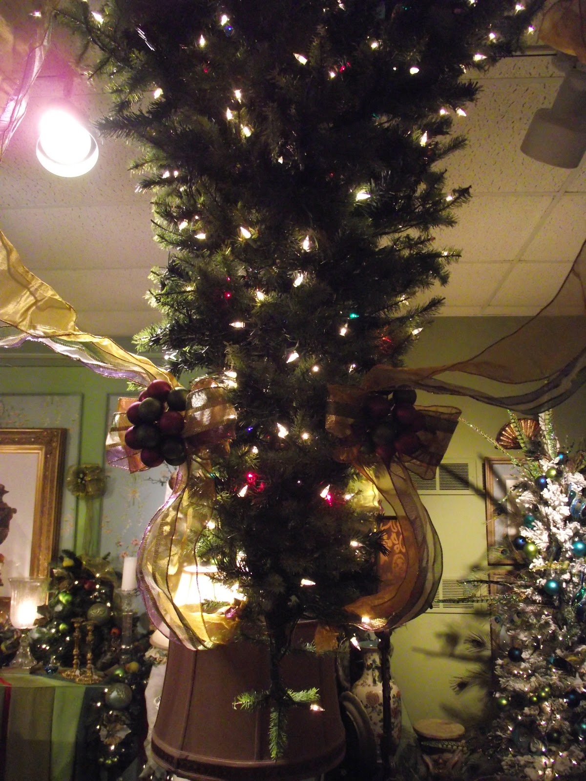 Decorating an Upside Down Christmas Tree in purple olive and gold