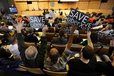 Uber supporters demonstrate at a Seattle City Council meeting