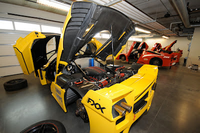 Yellow Ferrari FXX Engine Bay Open Servicing Pits