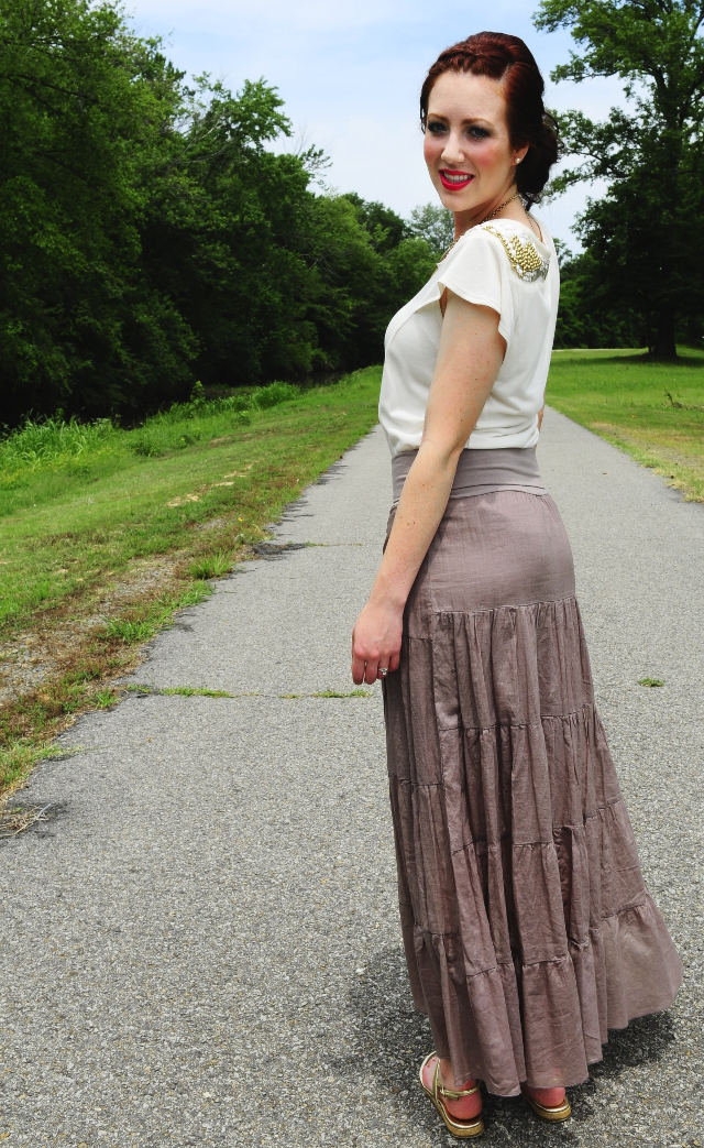 Back view of cream blouse and tan tiered skirt
