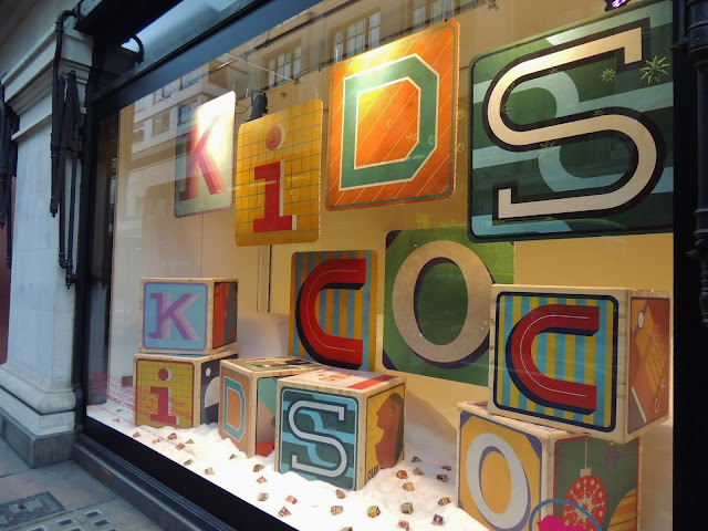 Child's toy blocks spelling out Kids Company