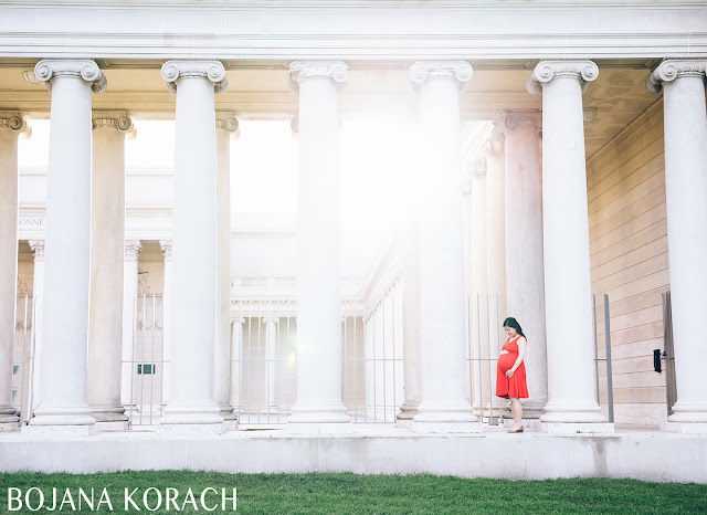 beautiful image of legion of honor in san francisco and pregnant woman wearing a red dress by bojana korach photography
