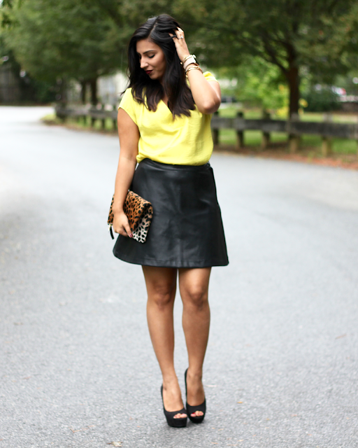 faux leather skirt, yellow satin blouse, leather skirt, a line leather skirt, leopard clutch, clare v, clare v clutch, kat von d vampira, kendra scott, apple watch fashion, fashionable apple watch
